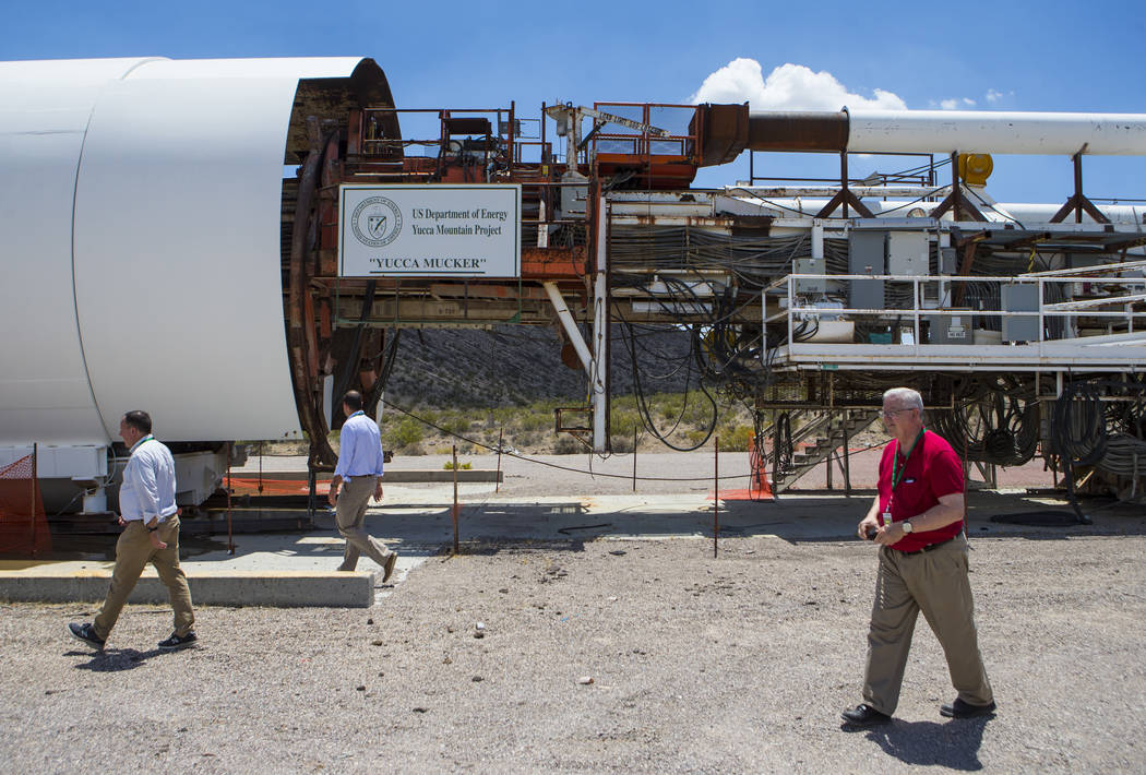People walk by the Yucca Mucker, which bore the tunnel through Yucca Mountain, during a congressional tour of the area near Mercury on Saturday, July 14, 2018. Chase Stevens Las Vegas Review-Journ ...