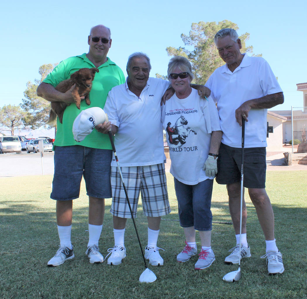 Robin Hebrock/Pahrump Valley Times Teams of four, such as the happy quartet shown, took part in the Silver Tappers Golf Tournament, helping add to the cash being collected for Nye County Search an ...