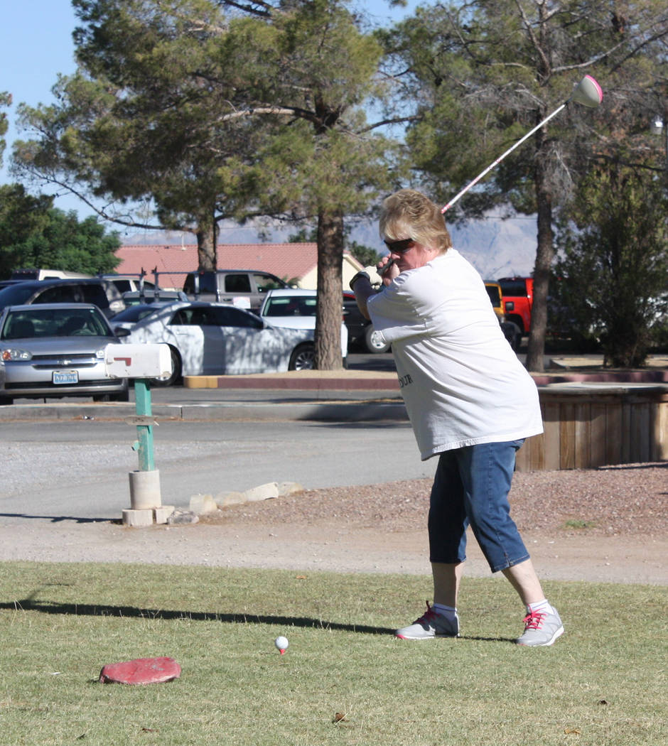 Robin Hebrock/Pahrump Valley Times A golfer tees off at the first hole for her team.