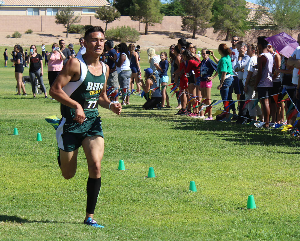 Tom Rysinski/Pahrump Valley Times Jose Granados nears the finish line during the Junior/Senior race at the Labor Day Classic cross country meet, where he finished 14th in his second race.