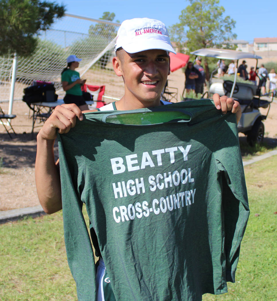 Tom Rysinski/Pahrump Valley Times Beatty junior Jose Granados shows off the sweatshirt his father had made when he became the only member of his school's cross country team.