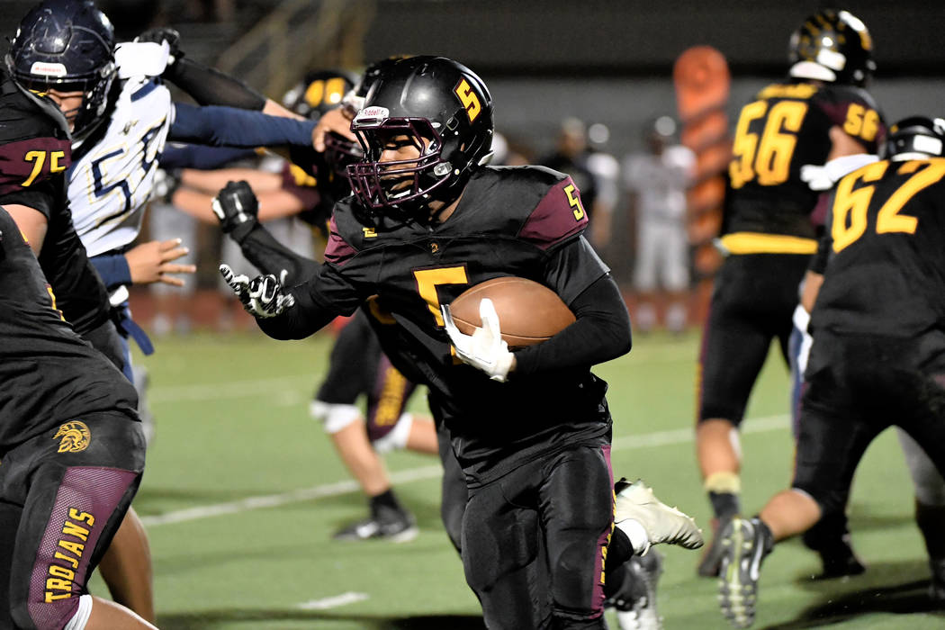 Peter Davis/Special to the Pahrump Valley Times Senior Casey Flennory led Pahrump Valley's rushing attack with 126 yards Friday night as the Trojans dominated Cheyenne 38-12 to move into first pla ...