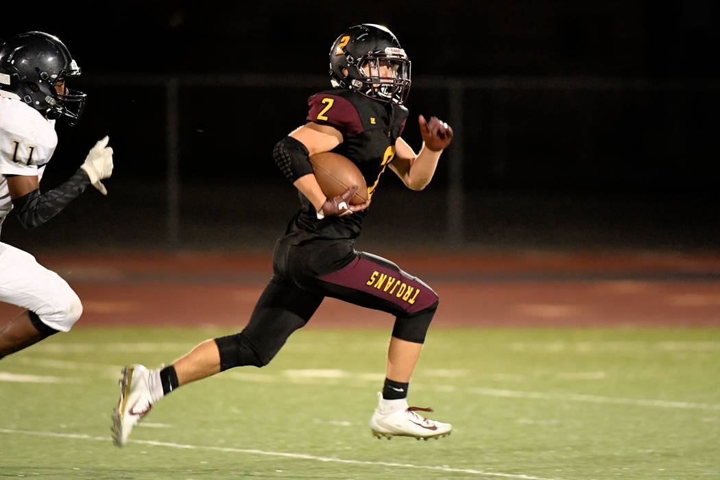 Peter Davis/Special to the Pahrump Valley Times Pahrump Valley senior Joey Koenig scampers toward the end zone for a 51-yard touchdown Friday night against Cheyenne. Koenig ran for two scores and ...