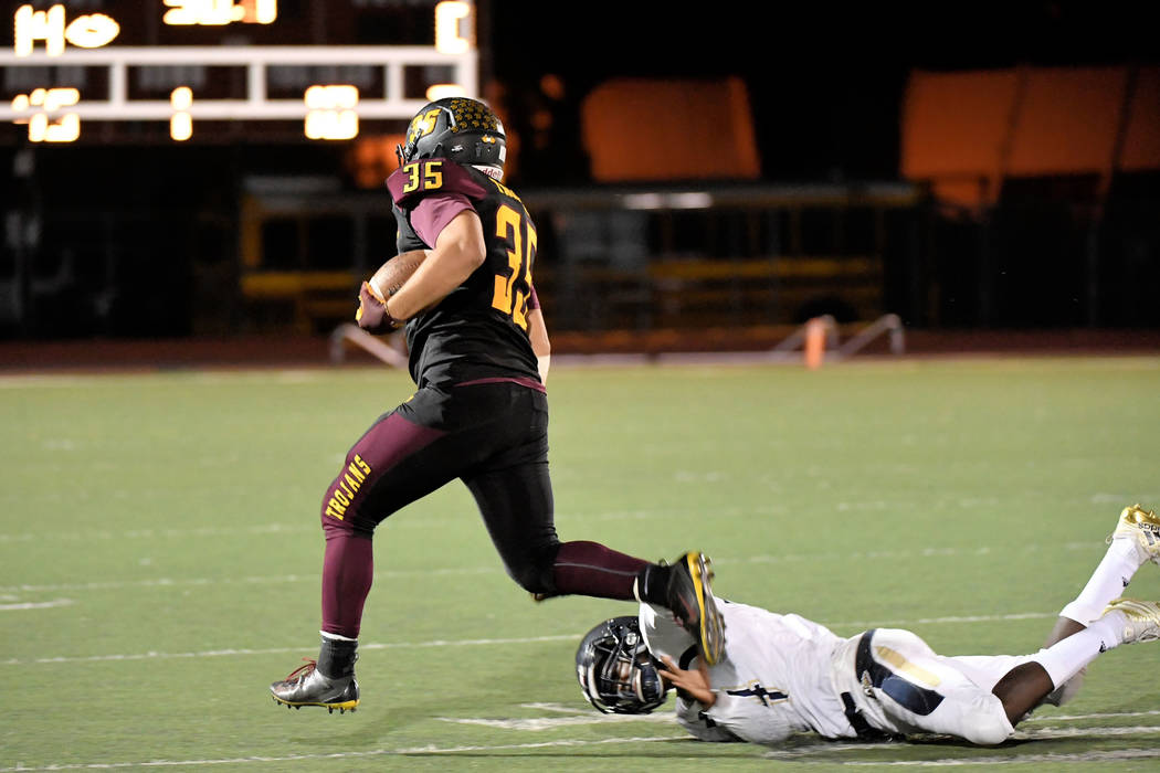 Peter Davis/Special to the Pahrump Valley Times Nico Velazquez breaks free for some of his 104 rushing yards as three Pahrump Valley backs reached 100 yards in the Trojans' 38-12 rout of Cheyenne ...