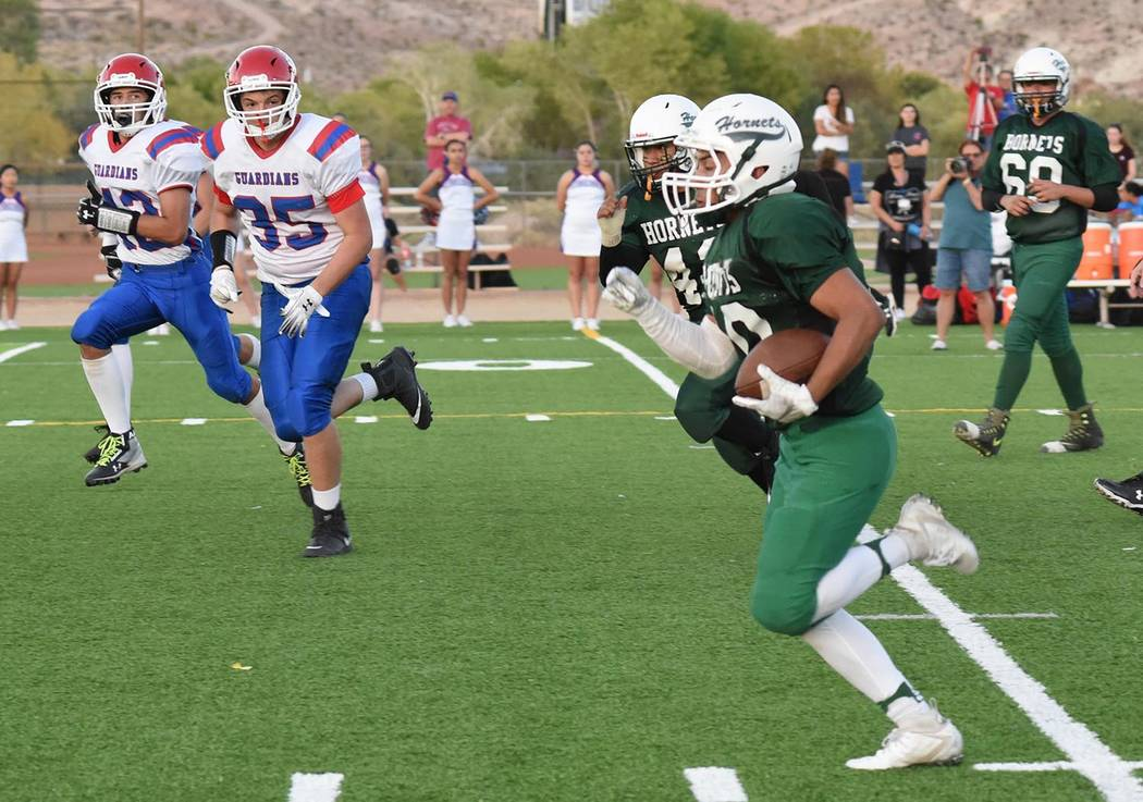 Richard Stephens/Special to the Pahrump Valley Times Beatty junior Fabian Perez finds running room against the Green Valley Christian defense Thursday during the Hornets' 40-6 win over the Guardians.