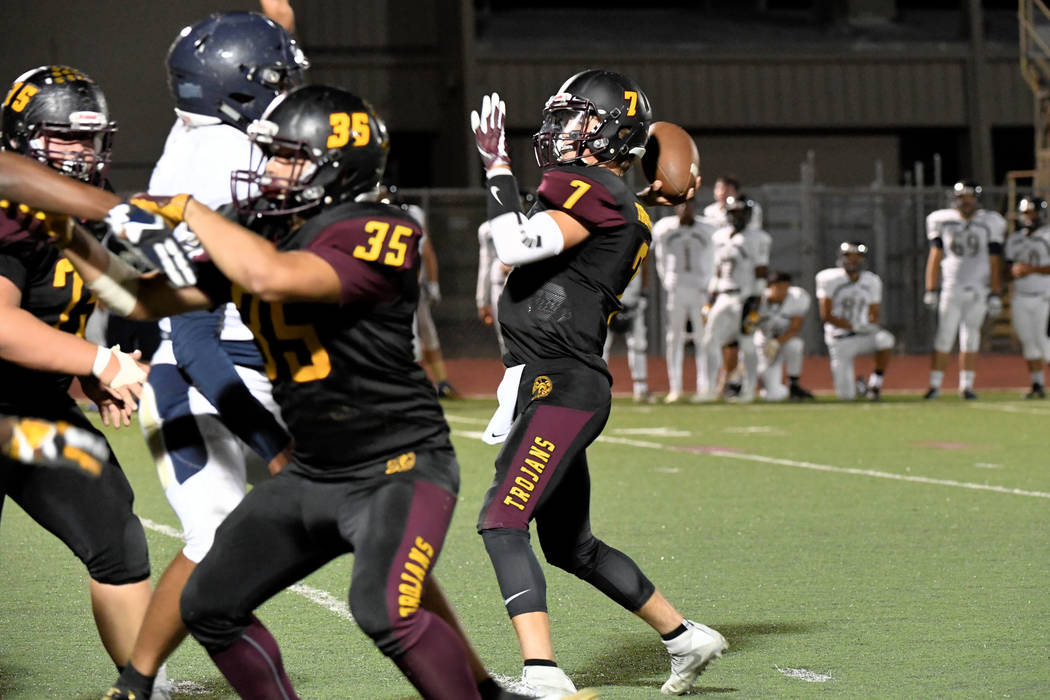 Peter Davis/Specail to the Pahrump Valley Times Dylan Wright goes back to pass during Pahrump Valley's key Class 3A Sunset League victory over Cheyenne on Friday night in Pahrump.