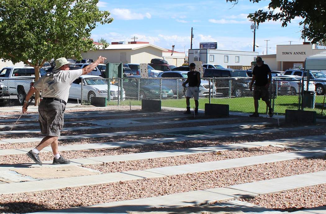 Tom Rysinski/Pahrump Valley Times Chuck Hickstein, at just short of 86 the oldest player in the tournament, competes in the final round of the Pahrump Fall Festival Horseshoes Tournament on Saturd ...