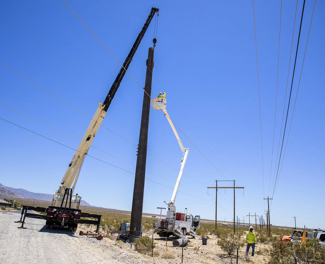 Jeff Scheid/Valley Electric Association Valley Electric announced that work had been completed on moving three 75-foot power poles, each weighing around 12,000 pounds, at Spring Mountain.