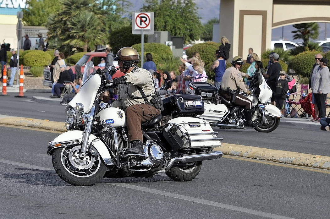 Horace Langford Jr./Pahrump Valley Times Two Nye County sheriff's motorcycle patrol officers display their adroit and agile handling skills along a parade route as shown in a file photo.