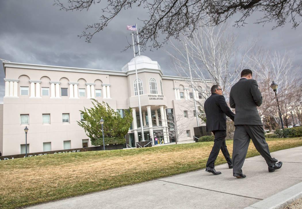 Benjamin Hager/Las Vegas Review-Journal Legislators walk into the Legislative Building during the fourth day of the Nevada Legislative session on Thursday, Feb. 9, 2017, in Carson City. Dennis Hof ...
