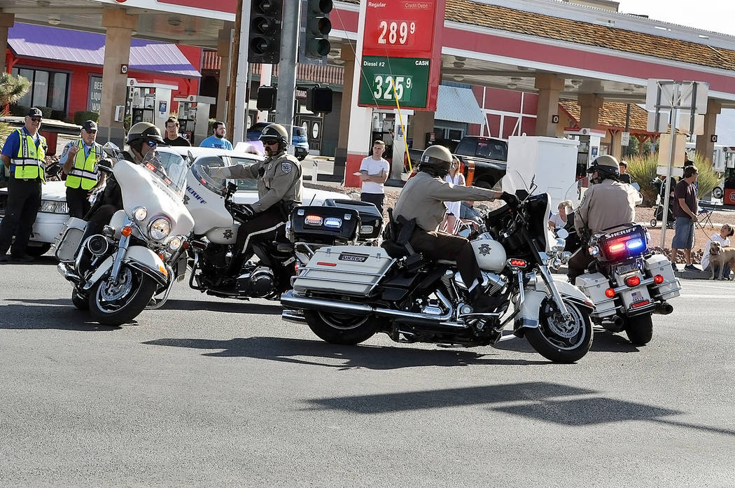 Horace Langford Jr./Pahrump Valley Times Showing their adeptness and keen skills, a team of Nye County Sheriff's Office motorcycle patrol deputies perform tricky maneuvers at the intersection of ...