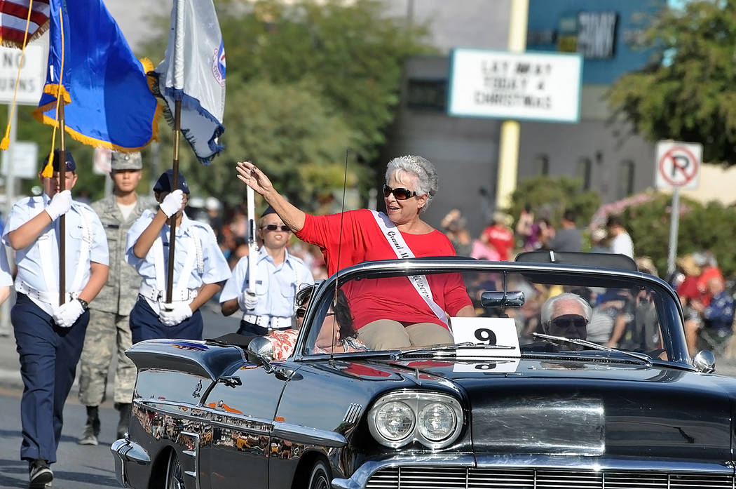 Horace Langford Jr./Pahrump Valley Times Pahrump Fall Festival 2018, parade Grand Marshall and Pioneer Territory CASA Executive Director Willi Baer waves to onlookers lining the sidewalk along th ...