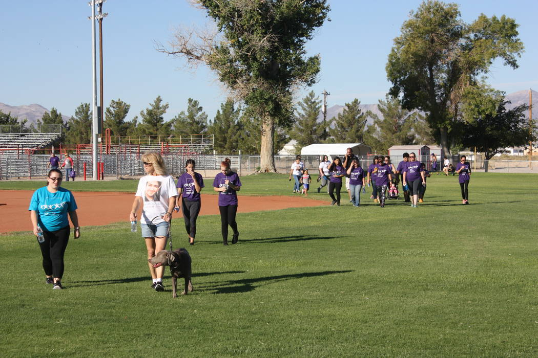 Robin Hebrock/Pahrump Valley Times Purple and teal were worn by many an attendee of the 2018 Walk In Memory, Walk For Hope event, hosted September 15 at Petrack Park. Others wore specially made T- ...