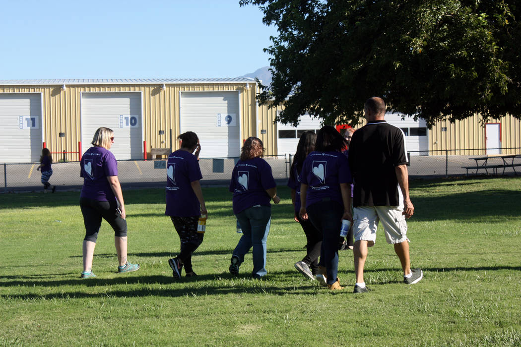 Robin Hebrock/Pahrump Valley Times Participants in the suicide prevention and awareness walk circled the grass at Petrack Park together, giving them a chance to connect with one another.