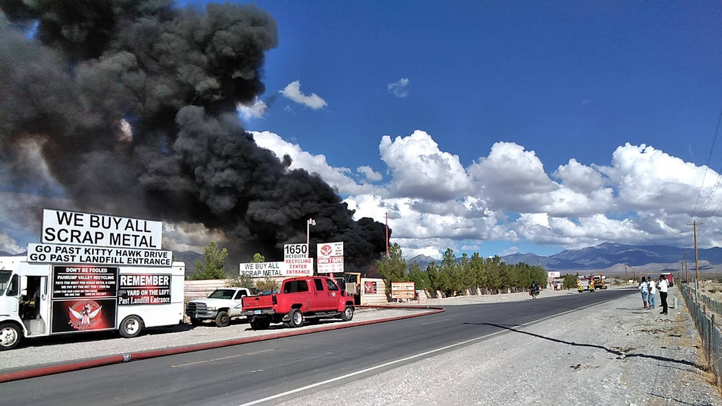 Selwyn Harris/Pahrump Valley Times Large plumes of thick black smoke could be seen throughout the valley as a result of Wednesday's recycling facility fire at 1650 East Mesquite Avenue. More than ...