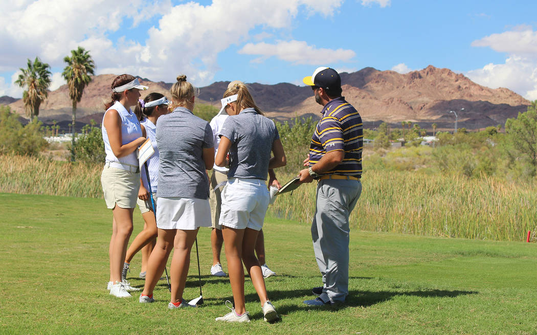 Tom Rysinski/Pahrump Valley Times From left, Pahrump Valley's Makalea Petrie and Breanne Nygaard, Boulder City's Sydney Krumm and Ryann Reese meet with the teams' coaches at the first hole Oct. 3 ...