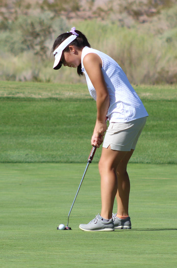 Tom Rysinski/Pahrump Valley Times Pahrump Valley sophomore Breanne Nygaard putts during a dual match against Boulder City on Oct. 3 at Boulder Creek Golf Club.