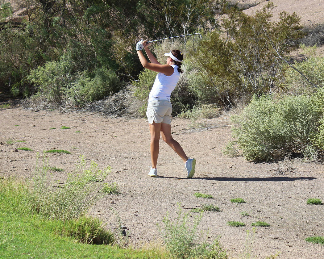Tom Rysinski/Pahrump Valley Times Senior Makalea Petrie swings from the rough Oct. 3 during Pahrump Valley's dual match against Boulder City at Boulder Creek Golf Club.