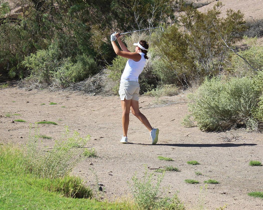 Tom Rysinski/Pahrump Valley Times Senior Makalea Petrie swings from the rough Oct. 3 during Pahrump Valley's dual match against Boulder City at Boulder Creek Golf Club.