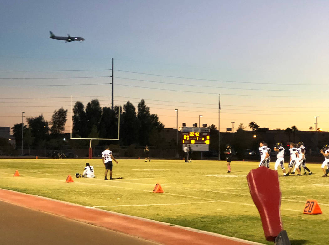 Tom Rysinski/Pahrump Valley Times Passengers on a flight coming in for a landing at McCarran International Airport had a brief view of the Pahrump Valley High School football team warming up for i ...