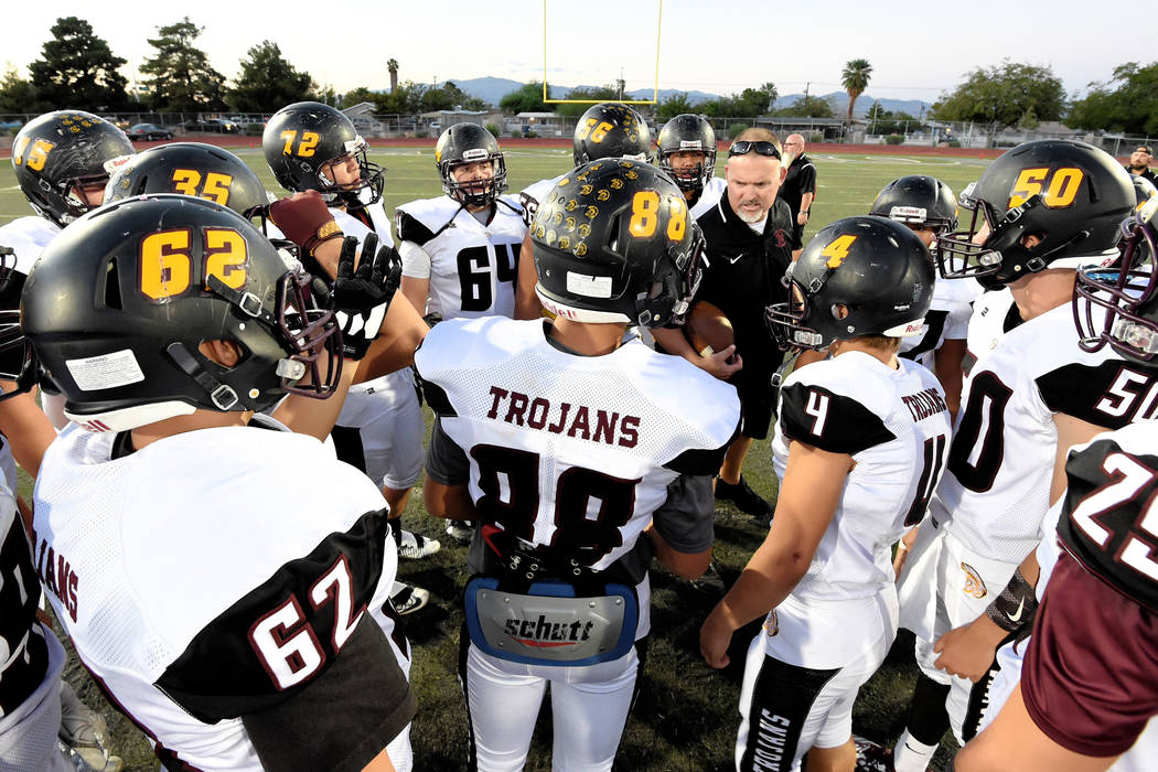 Peter Davis/Special to the Pahrump Valley Times Pahrump Valley football players gather around coach Joe Clayton for a pregame talk before taking on Democracy Prep, the first of what has become thr ...