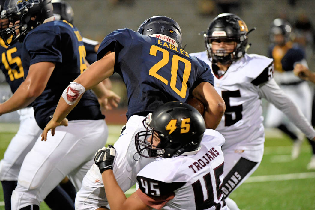 Peter Davis/Special to the Pahrump Valley Times Pahrump Valley senior Tristan Maughan, shown tackling Boulder City's Thorsten Ballmer earlier this season, had the first of four sacks against Del S ...