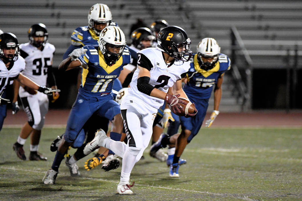 Peter Davis/Special to the Pahrump Valley Times Pahrump Valley's Joey Koenig finds running room to the outside during the Trojans' 48-25 win over Democracy Prep on Sept. 21 at Rancho High School i ...