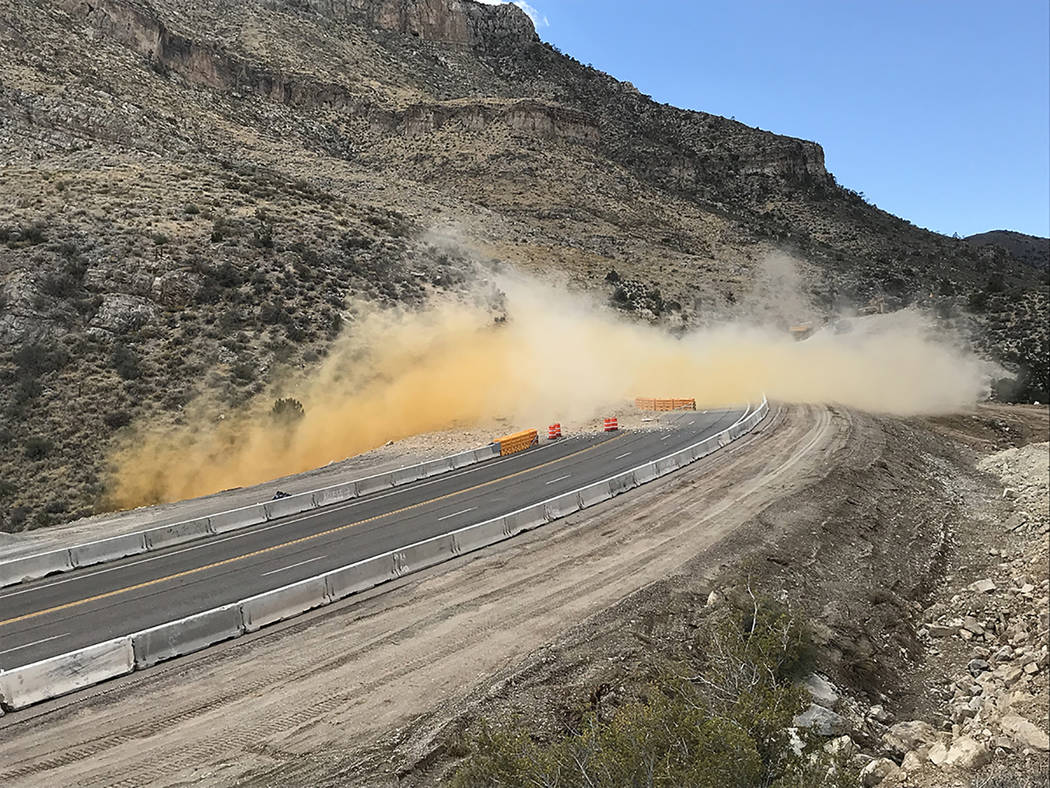 Nevada Department of Transportation A blast is shown along Nevada Highway 160 on Oct. 5 as crews continue their work on the project.