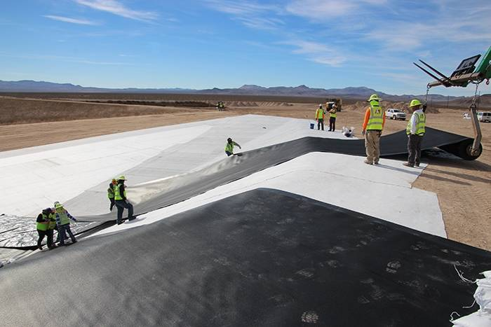Special to the Pahrump Valley Times/U.S. Department of Energy Workers install the first of two liners for a mixed low-level disposal cell at the Nevada National Security Site. The project was comp ...