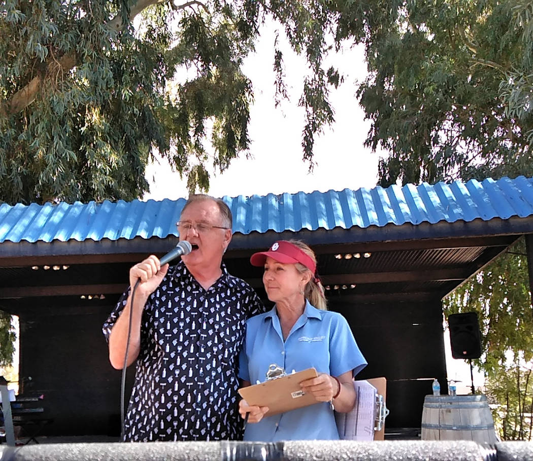Selwyn Harris/Pahrump Valley Times Pahrump Valley Winery owner Bill Loken calls for the next round of contestants during Saturday's portion of the annual grape stomp. The annual weekend event Loke ...