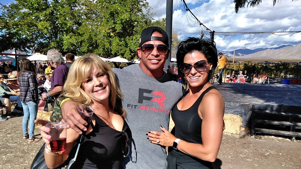Selwyn Harris/Pahrump Valley Times Las Vegas residents Kirsten Meador, left Brandon Hammer and his fiancee Jessi Glista actually stayed in Pahrump to compete in the annual grape stomp. Though Hamm ...