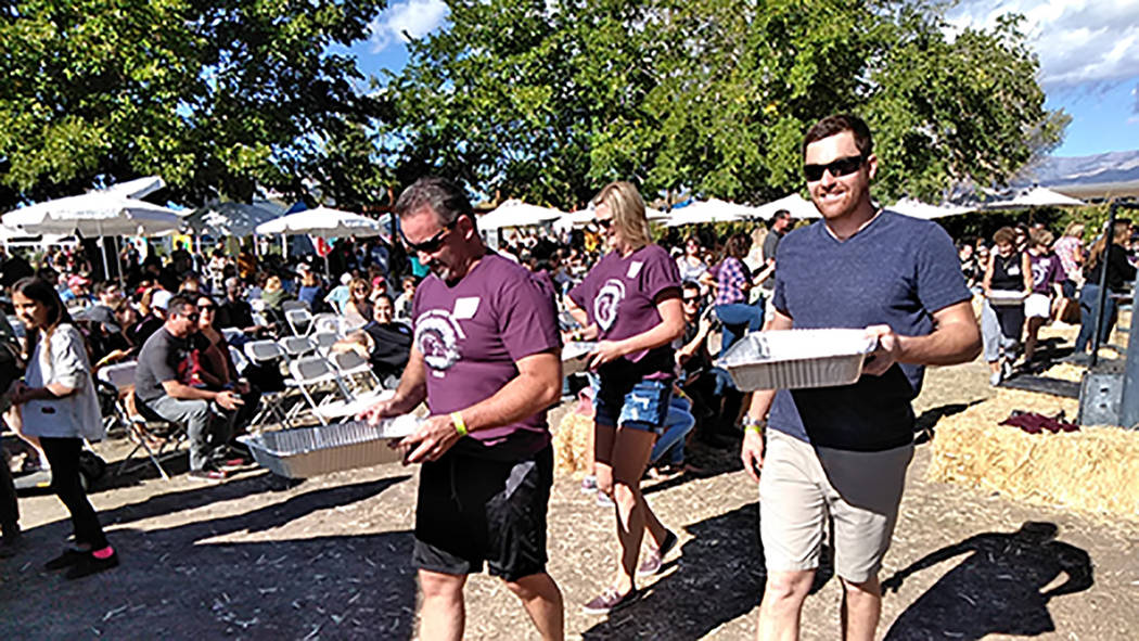 Selwyn Harris/Pahrump Valley Times Competitors carefully carry the fruit juice of their labor to the judging table. More than 30 vendors set up shop on the winery grounds this year. The winery rec ...