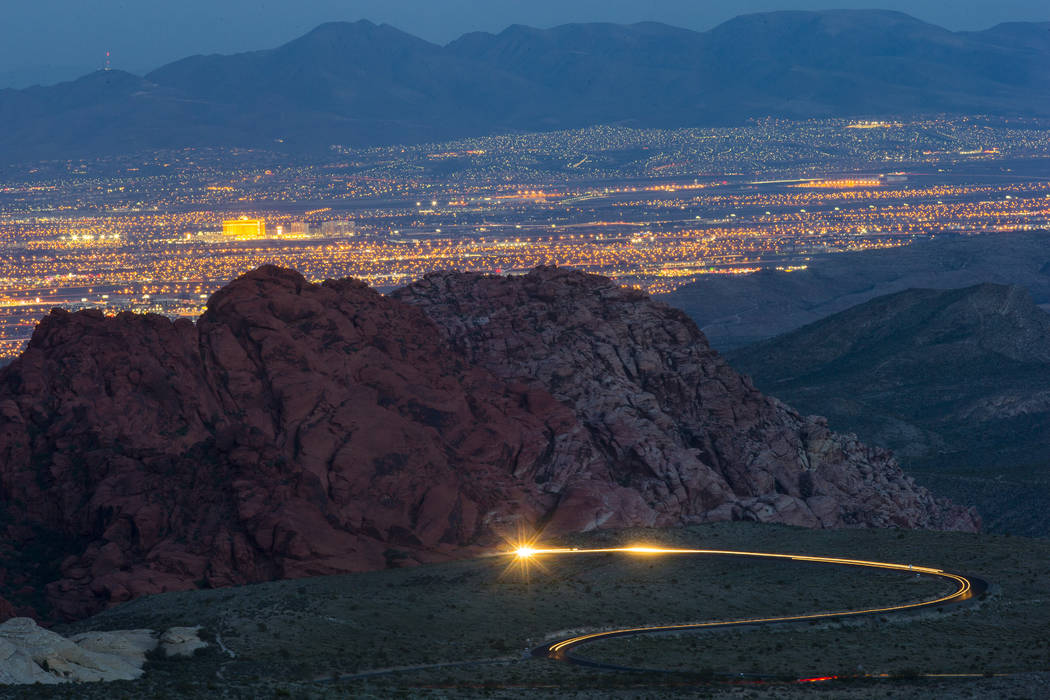 Cars drive along the 13-mile Scenic Drive at Red Rock Canyon National Conservation Area outside of Las Vegas on Wednesday, March 29, 2017. (Chase Stevens/Las Vegas Review-Journal) @csstevensphoto