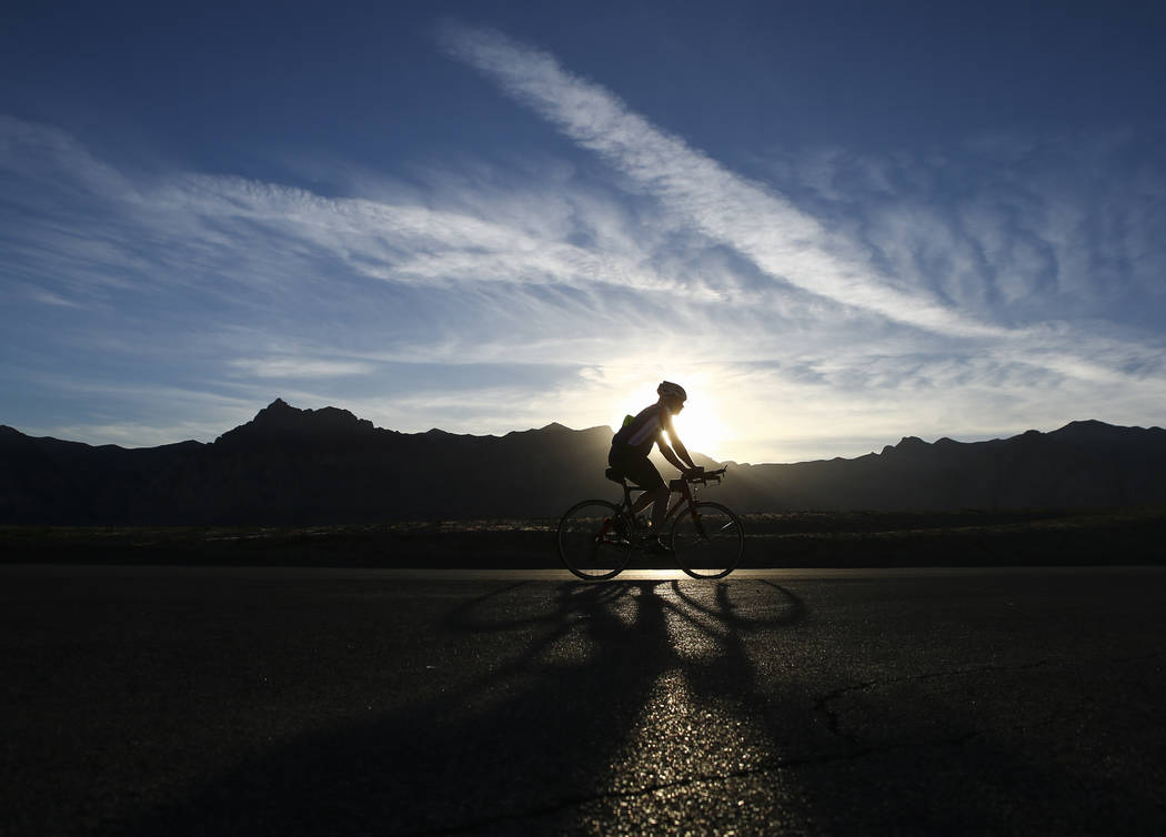 A cyclist rides along the 13-mile Scenic Drive at Red Rock Canyon National Conservation Area outside of Las Vegas on Wednesday, March 29, 2017. (Chase Stevens/Las Vegas Review-Journal) @csstevensphoto