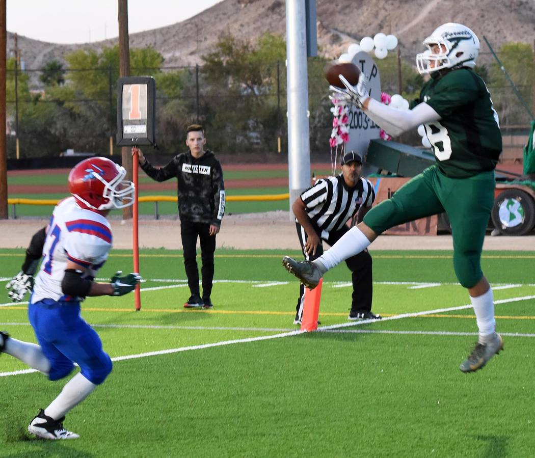 Richard Stephens/Special to the Pahrump Valley Times Beatty senior Geo Maldonado, shown catching a 2-point conversion pass against Green Valley Christian, caught a touchdown pass during the Hornet ...