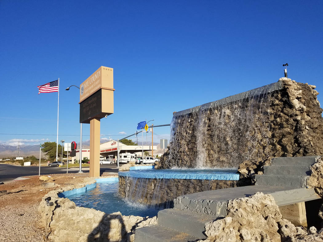 David Jacobs/Pahrump Valley Times Water pours from the Calvada fountain on Oct. 10, 2018. Nye County crews have been working on the fountain for the past few months; the project is not completed.