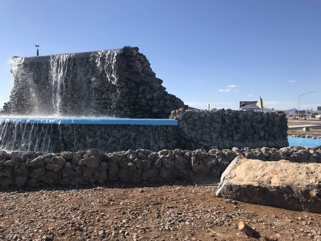 Jeffrey Meehan/Pahrump Valley Times Water flows from the fountain at Calvada Boulevard and Highway 160 on Wednesday after a long absence. Nye County officials stated the project is still in the te ...