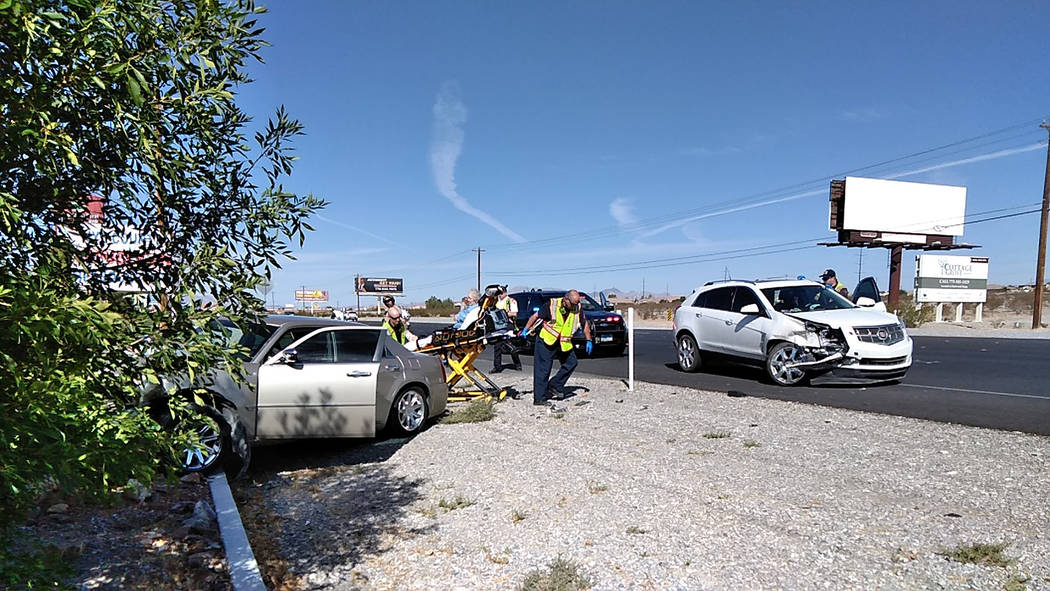 Selwyn Harris/Pahrump Valley Times Pahrump Valley Fire and Rescue crews prepare to transport an elderly woman involved in Wednesday morning's two-vehicle crash along Highway 160, near Rainbow Stre ...