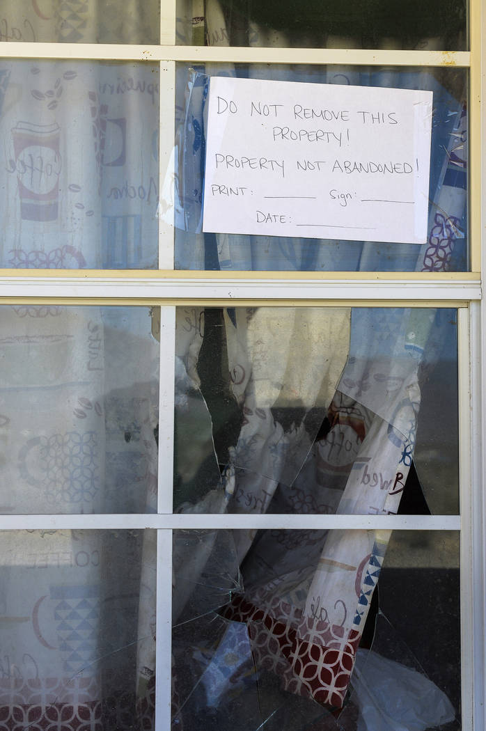 Signs posted by Nevada Legal Services are taped on the windows of the makeshift homes on the property behind the Nugget Hotel and Casino in Pahrump, Wednesday, Sept. 19, 2018. Caroline Brehman/Las ...