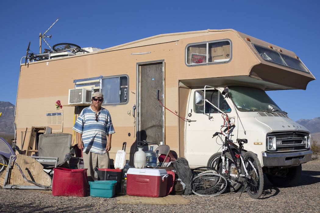 """Homeless resident Timothy Persson, 60, poses for a photograph outside of his trailer located on a vacant property west of the lot known as """"The Hill"""" after being forced to relocate in Pa ..."""