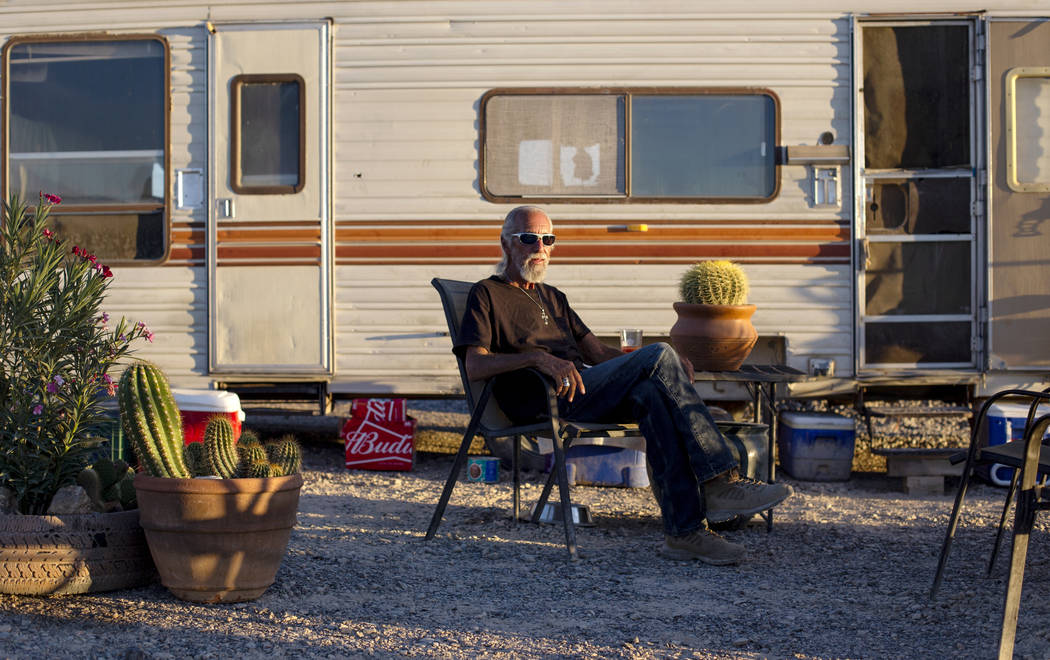Homeless resident Rich poses for a photograph outside of his trailer that sits on a lot west of the property behind the Nugget where him and several others have temporarily relocated in Pahrump, W ...