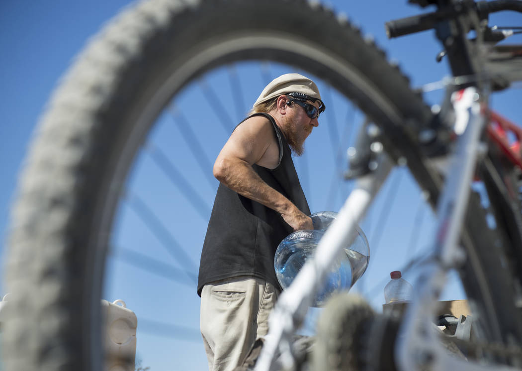 Homeless resident Timothy Persson, 60, packs up his belongings laying outside of his trailer in preparation of moving his trailer to a third location within two weeks in Pahrump, Wednesday, Sept. ...