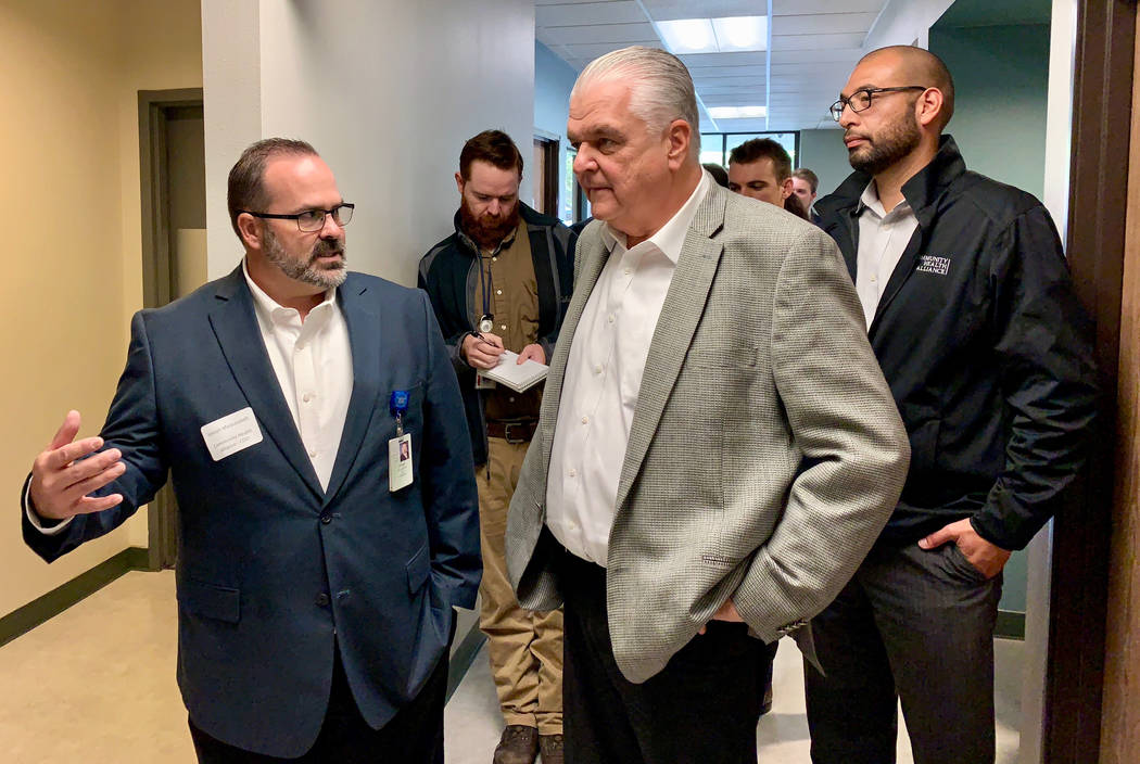 Clark County Commission Chair and Democratic candidate for Nevada governor Steve Sisolak, center, gets a tour of the Community Health Alliance's Reno facility from CHA Chief Operating Officer Jose ...