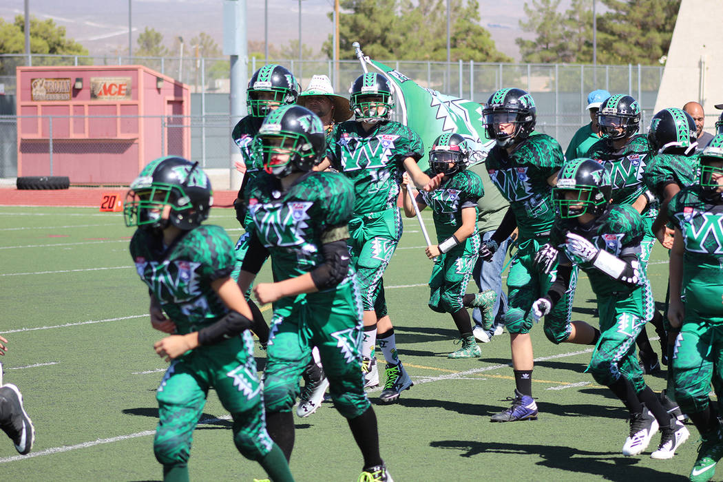Tom Rysinski/Pahrump Valley Times The Pahrump Warriors 13U football team takes the field for a game earlier this season at Trojan Field in Pahrump. The Warriors defeated the Faith Lutheran Crusade ...
