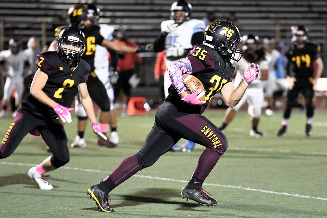 Peter Davis/Special to the Pahrump Valley Times Pahrump Valley senior Nico Velazquez finds plenty of running room while Joey Koenig, left, looks for someone to block Friday night against Western. ...
