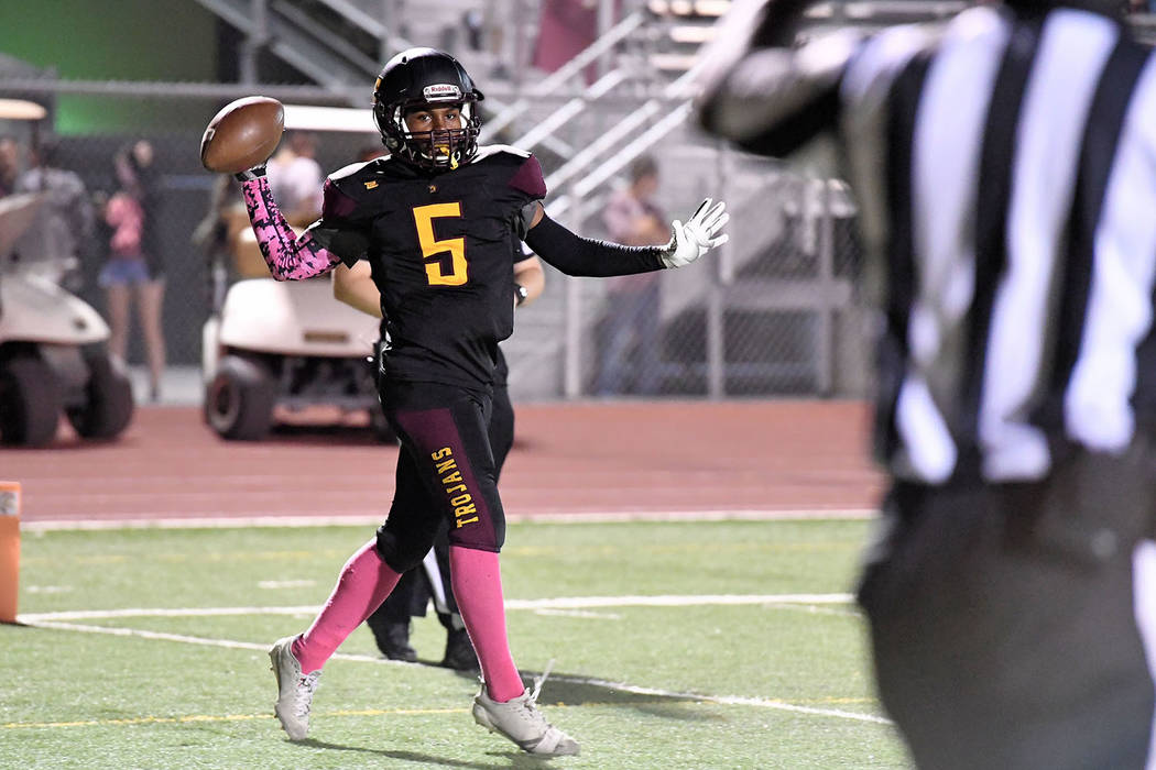 Peter Davis/Special to the Pahrump Valley Times Senior Casey Flennory tosses the ball to an official after scoring on a 22-yard screen pass from Dylan Wright during Pahrump Valley's 66-0 win over ...