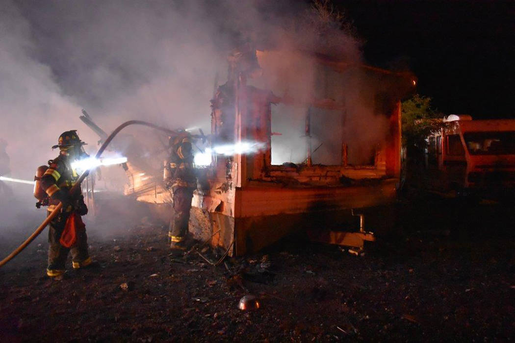 "Special to the Pahrump Valley Times Fire crews performed what's termed a ""blitz"" shortly after arriving on scene. the method involves using hand lines to dump lots of water in a short amount of ..."