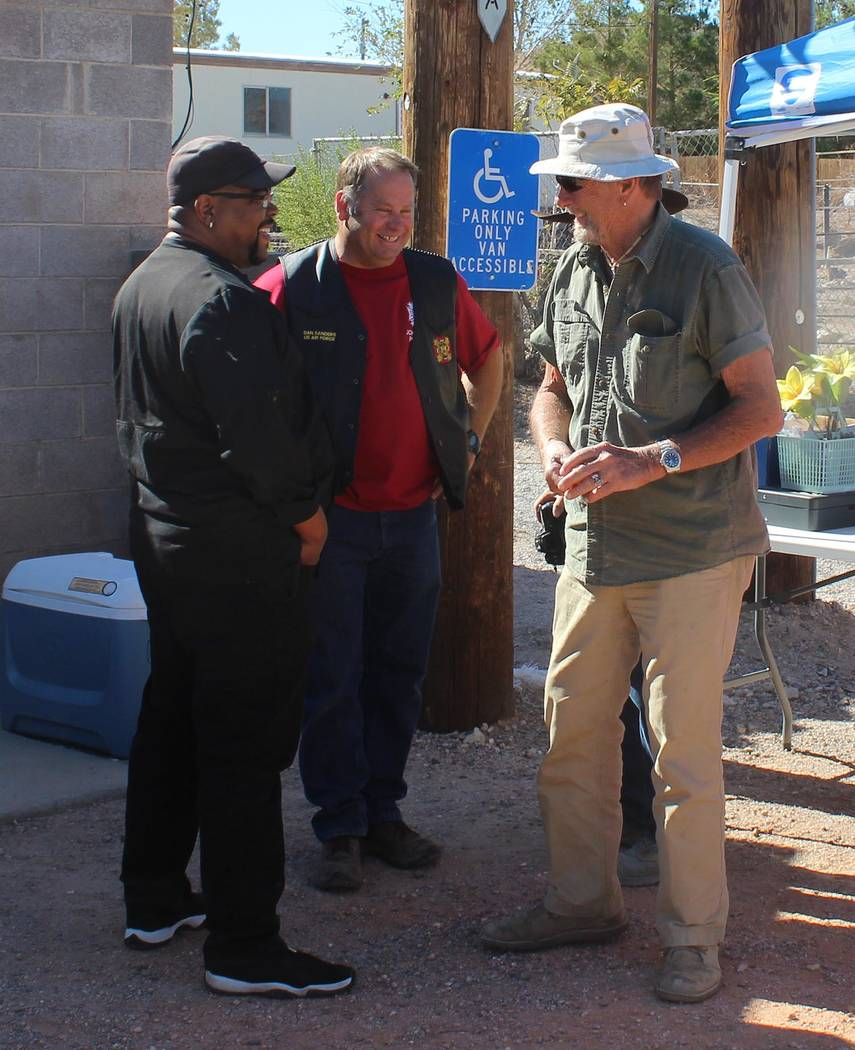 Tom Rysinski/Pahrump Valley Times From left, Chandler Vaughn, who prepared all of the food for the Poker Run, Dan Sanders, VFW Post #12109 commander, and Poker Run organizer Karl Olson chat before ...