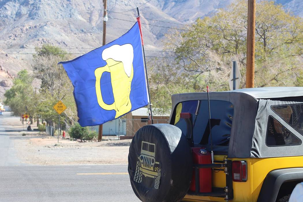 Tom Rysinski/Pahrump Valley Times A vehicle proudly flies a banner most Poker Run participants can rally around Saturday in the parking lot of the VFW in Beatty.