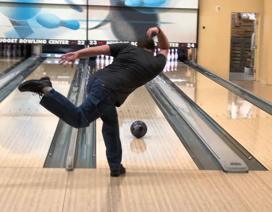 Tom Rysinski/Pahrump Valley Times Zahn Bouder of Pahrump tests out a new ball Wednesday morning after bowling in his league at the Pahrump Nugget Bowling Center.
